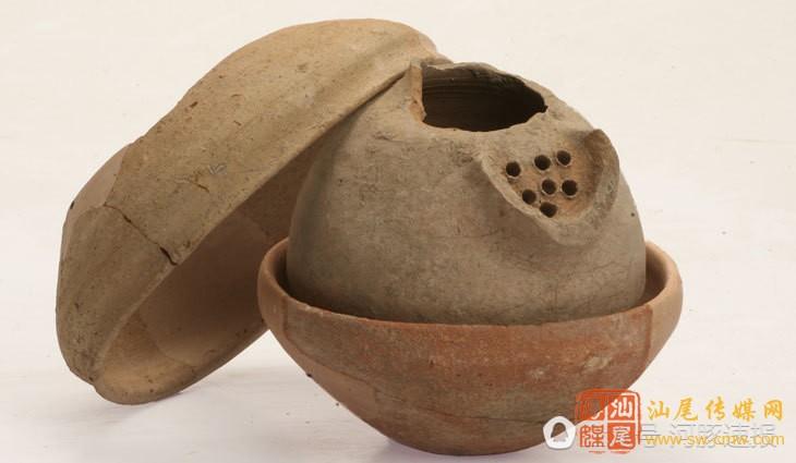 3100年前酒罐装满珠宝